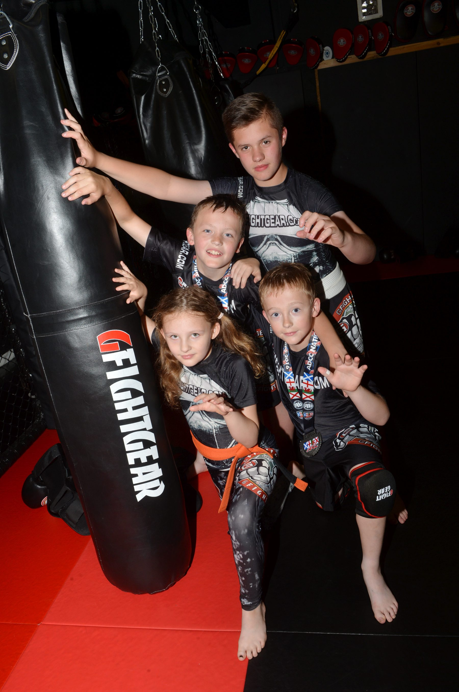 Pictured at the GLADIATOR MMA GYM, THE NEST UNIT 18, TRENT TRADING PARK, MELVILLE STREET, HANLEY, ST1 3LY as local MMA fighters win medals at a recent event in Fenton, having entered at just 10 days' notice.  Pictured left to right are 10-year-old Amy Clarke who won silver in the 40kg+ seven-10-years section, Charlie Robinson, aged nine, who took bronze in the same event as brother Bailey Robinson, aged 10, who took silver in the -40kg weight division having met each other in the semi-finals and  Reece Grocott, aged 13, who took gold in the +55kg category of the 11-14 year-olds section.