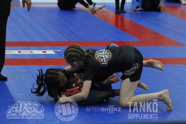 two girls grappling
